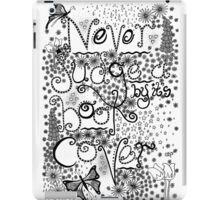 Never Judge a Book by it's Cover iPad Case/Skin
