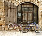 Old bickes on the old street by Margarita K