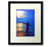 Swimming in the evening ocean Framed Print