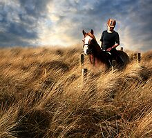 """Riding through a sea of grass"" by Raymond Kerr"