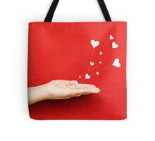Blowing Hearts from a Hand Tote Bag