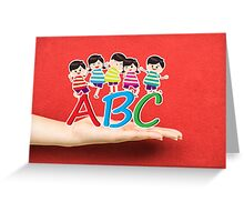 happy Kids Playing with letter and on hand Greeting Card