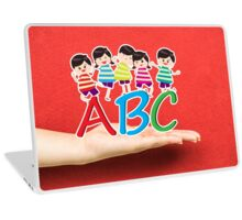 happy Kids Playing with letter and on hand Laptop Skin