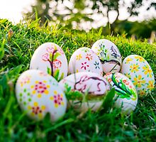 Colorful Easter eggs in a field of grass by ngocdai86