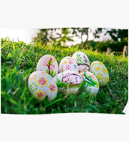 Colorful Easter eggs in a field of grass Poster