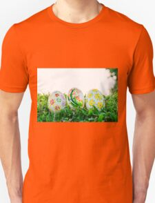 Row of Easter Eggs with Daisy on Fresh Green Grass T-Shirt