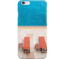 poolside deckchairs alongside blue swimming pool from top view iPhone Case/Skin