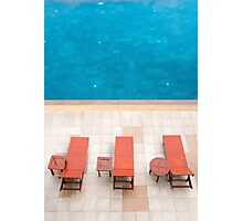 poolside deckchairs alongside blue swimming pool from top view Photographic Print