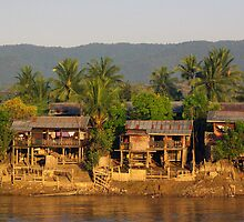 Village at dawn.  Irrawaddy River, Burma. by John Mitchell