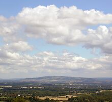 Bredon Hill seen across the Vale of Evesham from the Malvern Hills, English West Midlands by Philip Mitchell