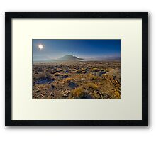Sun rising over the fog in the desert Framed Print