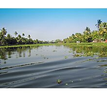 Ripples on the water of the saltwater lagoon in Alleppey Photographic Print