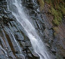 Water falling with force on black rocks at Bees Falls in Pachmarhi by ashishagarwal74
