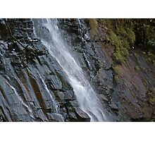 Water falling with force on black rocks at Bees Falls in Pachmarhi Photographic Print