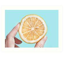 Juicy lemon on a blue background Art Print