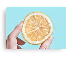 Juicy lemon on a blue background Canvas Print