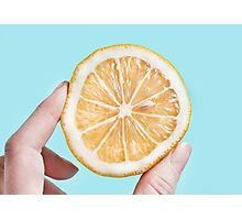 Juicy lemon on a blue background Photographic Print