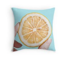 Juicy lemom on a blue background Throw Pillow