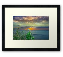 yellow sunset over loop head with thistles Framed Print
