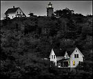 Monhegan lighthouse at Dusk by Dave  Higgins