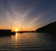 Sunset over Polkerris, South Cornwall by Laura Davey