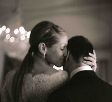 Bride and groom kissing in wedding sepia medium format film by edwardolive