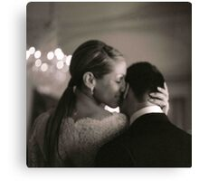 Bride and groom kissing in wedding sepia medium format film Canvas Print