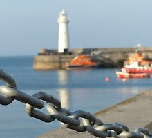 Chained up at the harbor - lovely photo of a lighthouse and harbor by verypeculiar