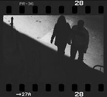 Man and woman holding hands in film noir analog 35mm film photo by edwardolive