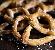Bavarian Salted Fresh Dough Pretzels on Rustic Wood by HotHibiscus
