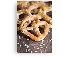 Pile of Salty Baked Bavarian Pretzels on Dark Wood Canvas Print