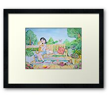 The girl and the cats Framed Print