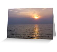 View of sunset through clouds and over the water of the Arabian Sea in Lakshadweep Islands Greeting Card