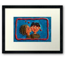 a kiss Framed Print