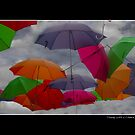 Cloudy with a Chance of Umbrellas Poster by Wayne King