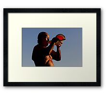Blowing the Pū at Sunset Framed Print