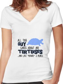 All this guy cares about are tortoises... (Black & Blue) Women's Fitted V-Neck T-Shirt