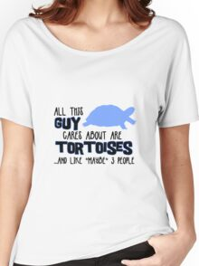 All this guy cares about are tortoises... (Black & Blue) Women's Relaxed Fit T-Shirt