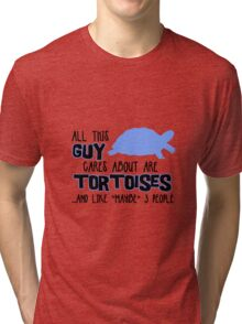 All this guy cares about are tortoises... (Black & Blue) Tri-blend T-Shirt