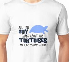All this guy cares about are tortoises... (Black & Blue) Unisex T-Shirt