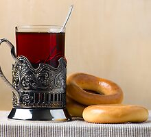 Tea and bread-rings by Mikhail Kovalev