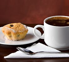 Black coffee and muffin by Mikhail Kovalev