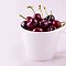 Cherries in a white cup by MaShusik