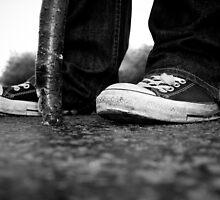 walking man [in converse] by Jonathan Oakley