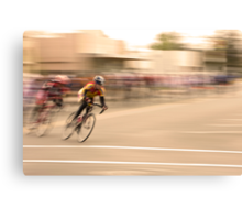 Cyclists Coming Around a Curve and into the Straightaway Canvas Print