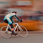 A Lone Cyclist Heads into the Final Lap by Buckwhite