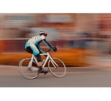 A Lone Cyclist Heads into the Final Lap Photographic Print
