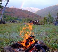 Campfire and Rainbow in Yellowstone by Ryan Harvey