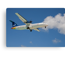 liat airlines fly over Maho beach in St Maarten Canvas Print