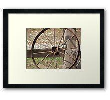 A Bird Sitting on a Old Wagon Wheel Framed Print